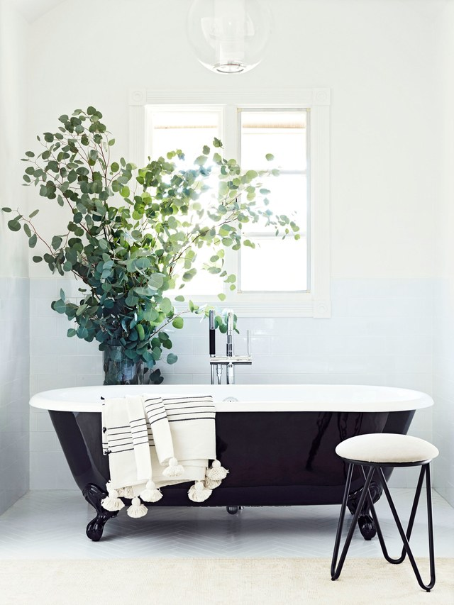 black & white bathroom, black tub, white tiles white paint